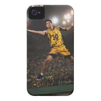 Young man jumping and holding basketball iPhone 4 covers