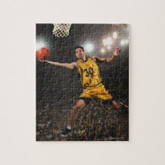 Young man jumping and holding basketball jigsaw puzzle