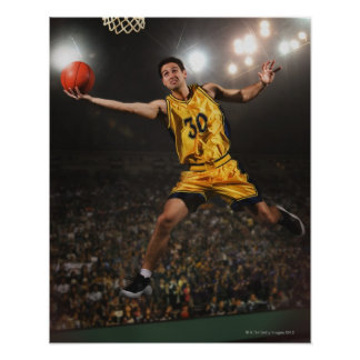 Young man jumping and holding basketball poster