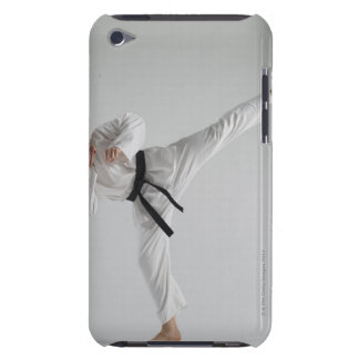 Young man performing karate kick on white barely there iPod covers