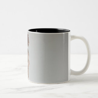 Young man performing karate stance on white Two-Tone coffee mug