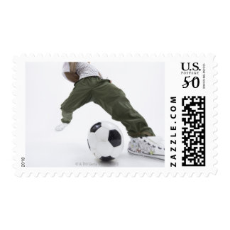 Young man playing soccer 2 postage