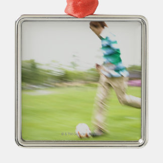Young Man Playing Soccer Metal Ornament
