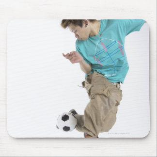 Young man playing soccer mouse pad