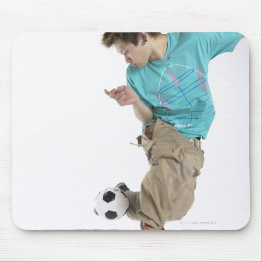 Young man playing soccer mousepad
