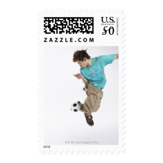 Young man playing soccer postage