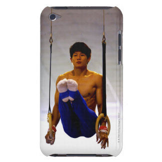 Young man practicing gymnastic rings iPod touch case