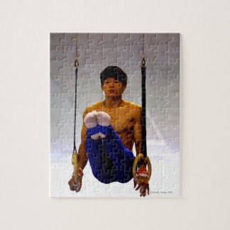Young man practicing gymnastic rings jigsaw puzzles