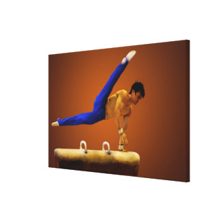 Young man practicing gymnastics on the pommel gallery wrap canvas