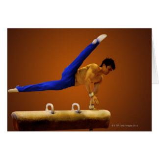 Young man practicing gymnastics on the pommel card