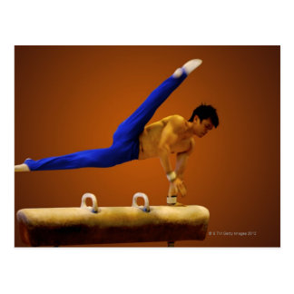 Young man practicing gymnastics on the pommel postcard