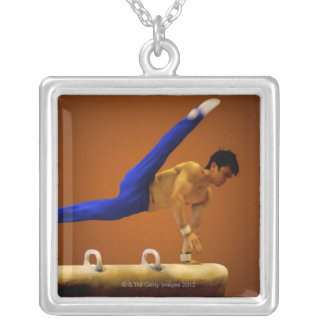 Young man practicing gymnastics on the pommel square pendant necklace
