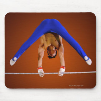 Young man practicing on the horizontal bar mouse pad
