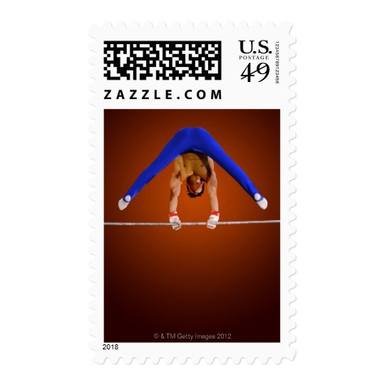 Young man practicing on the horizontal bar postage