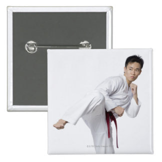 Young man practicing side kick 2 inch square button