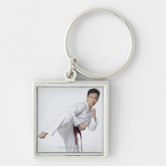 Young man practicing side kick keychain