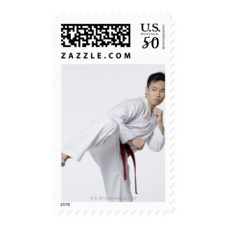 Young man practicing side kick postage
