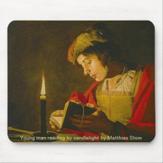 Young man reading by candlelight mouse pad