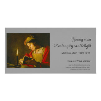 Young man reading by candlelight photo greeting card