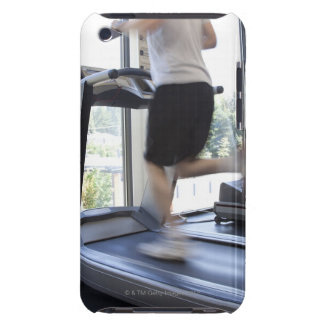 Young man running on a treadmill at health club, iPod Case-Mate case