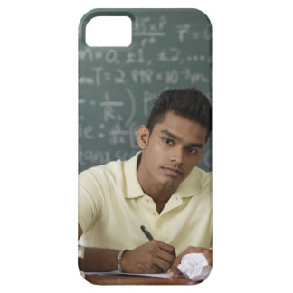 young man sitting at his desk, writing iPhone SE/5/5s case