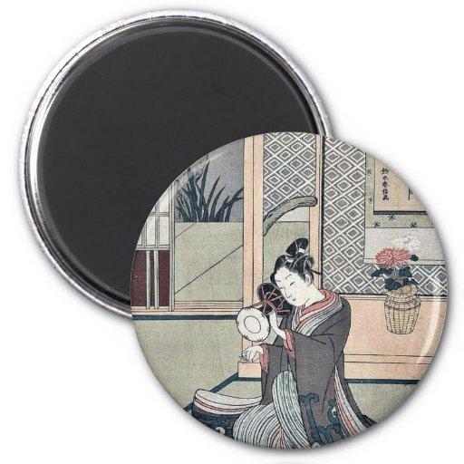 Young man striking a drum by Suzuki, Harunobu Magnet
