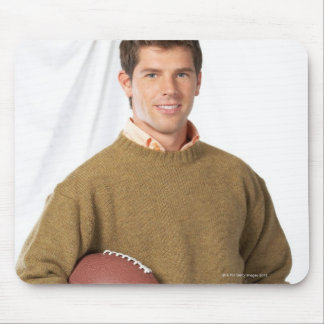 Young man with a football mouse pad