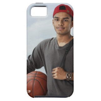young man with red cap holding basket ball and iPhone SE/5/5s case