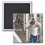 Young man working out his triceps on a cable 2 inch square magnet