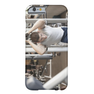 Young man working out his triceps on a cable barely there iPhone 6 case