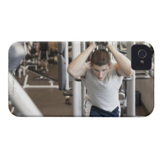 Young man working out his triceps on a cable Case-Mate iPhone 4 case