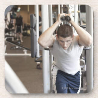 Young man working out his triceps on a cable coaster