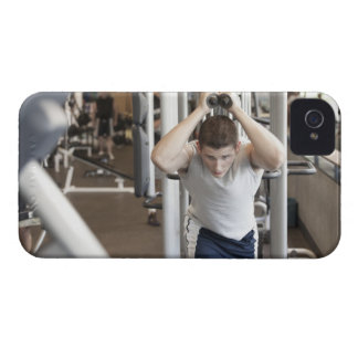 Young man working out his triceps on a cable iPhone 4 cover