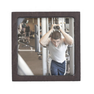 Young man working out his triceps on a cable keepsake box