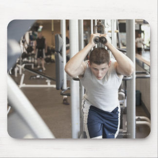 Young man working out his triceps on a cable mouse pad