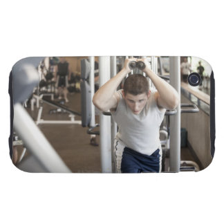 Young man working out his triceps on a cable tough iPhone 3 cover