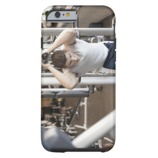 Young man working out his triceps on a cable tough iPhone 6 case