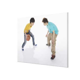 Young men playing basketball canvas print