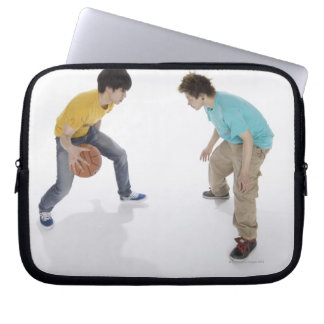Young men playing basketball laptop sleeve