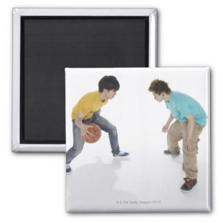 Young men playing basketball magnet