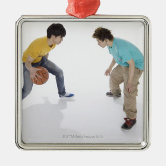 Young men playing basketball metal ornament