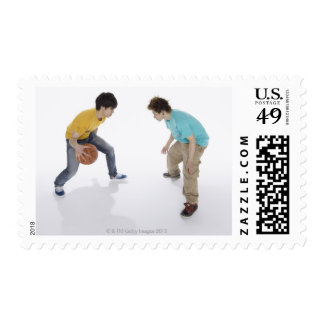 Young men playing basketball postage stamp