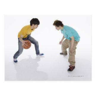 Young men playing basketball postcard