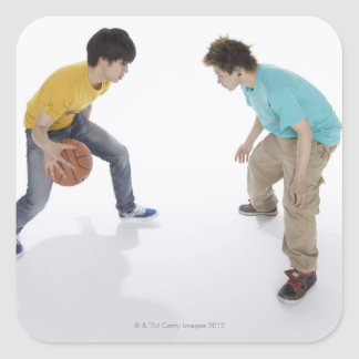 Young men playing basketball square sticker