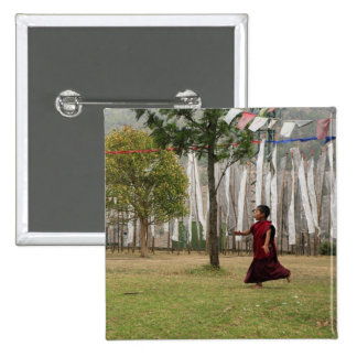Young monk and prayer flags 2 inch square button