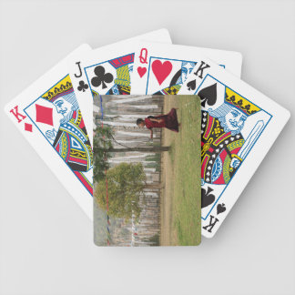 Young monk and prayer flags bicycle playing cards