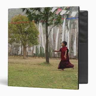 Young monk and prayer flags binder