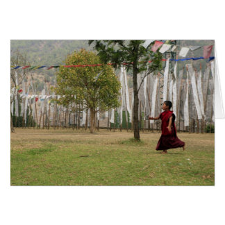 Young monk and prayer flags card