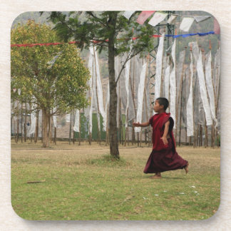 Young monk and prayer flags drink coaster