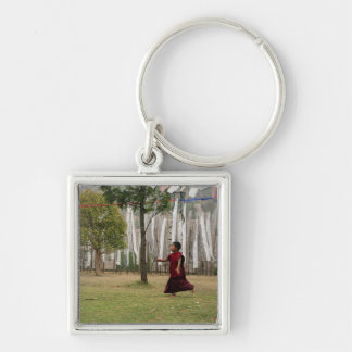 Young monk and prayer flags keychain
